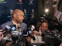 Who needs games? Logos were on display at a Vince Carter press conference.