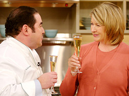 Chef Emeril Lagasse and Martha Stewart raise their glasses on her show.