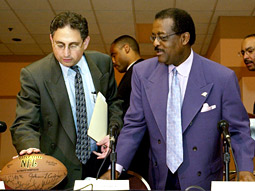 Getting the ball rolling: Cyrus Mehri (l.) makes things happen even when there's no lawsuit involved, as he did when he and Johnnie Cochran released a report on the lack of black coaches in the NFL, which led to numerous hires.