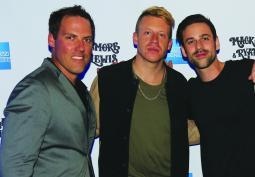 Momentum Worldwide's Glenn Minerley with Macklemore and Ryan Lewis.