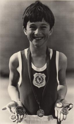 Young Chris Garbutt and his many medals