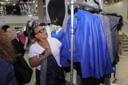 A shopper checks out the rack at Christian Siriano x Lane Bryant PA's fall launch Sept. 13 in New York City.