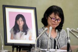 Yukimi Takahashi, whose daughter Matsuri killed herself in 2015 due to overwork, speaks to reporters about the agreement she reached with Dentsu Inc. on January 20, 2017 in Tokyo.