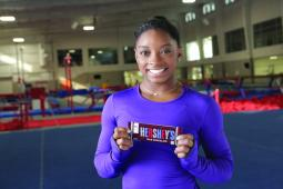 Gymnast Simone Biles is working with Hershey, which is hosting a s'mores party.