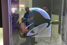 At Taco Bell's VR Arcade, a man gets some help putting his VR headgear on.