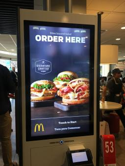 McDonalds Unveils New Customer Experience CMO Strategy Ad Age - Restaurant table advertising