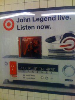 Go ahead, plug in. It's a John Legend Target subway poster.