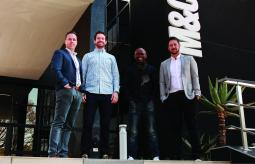 Levergy directors Clint Paterson, Struan Campbell and Kieren Jacobsen with M&C Saatchi Group Chairman Jerry Mpufane