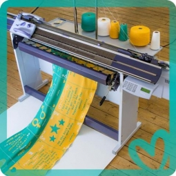 A knitting machine to crank out positive messages