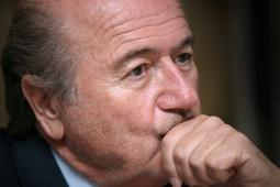 Sepp Blatter, the president of FIFA, listens during a news conference in central London, Monday, May 8, 2006.