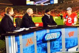 The Big Ten Network's lead studio host Dave Revsine with analysts Gerry DiNardo and Howard Griffith with Wisconsin quarterback Joel Stave.