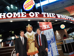 Burger King CEO John Chidsey (left), and new Europe, Middle East and Africa president Kevin Higgins (right) pose alongside the King.