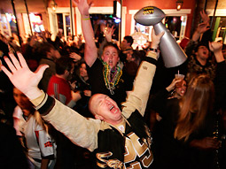 New Orleans Saints fans revel on Bourbon Street.