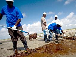 BP workers performing cleanup.