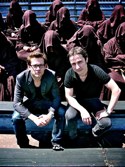 Luc Wise (left) and Andrea Stillacci (right), founders of the new Paris ad agency Herezie, with the monks.