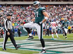 Brent Celek strikes the 'Captain Morgan' pose after scoring a touchdown.