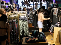 Once inside the store, the first 100 on line scrambled to find their favorite garments in the right size.