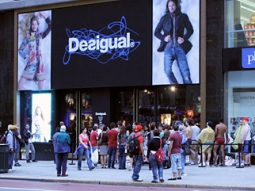 Tourists and exhibitionists stare at each other in front of the Desigual clothing store on 34th Street. These exhibitionists got free clothes for waiting hours outside in their underwear.