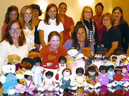 SMZ Advertising employees dress up dolls and teddy bears for the the Old Newsboys' Goodfellows Fund of Detroit's No Kiddie Without a Christmas effort.