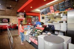 The new look of Domino's. CMO said the old stores 'are not the most welcoming.'