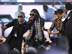 Jay-Z, Lil Wayne, M.I.A. and Kanye West perform at the Grammys.