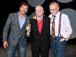Hugh Hefner receives a PromaxBDA Lifetime Achievement Award from Promax/BDA President-CEO Jonathan Block-Verk following a Q&A with CNN broadcast journalist Larry King.