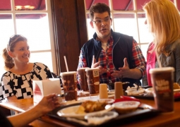 Jon Hein talks with diners about their love of fast food.