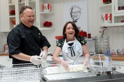 KFC U.S. head chef Bob Das teaches actress and comedienne Rachel Dratch how to make KFC Original Recipe fried chicken at the KFC Re-Colonelization event April 4, 2016, in New York City.