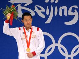 Japan's Kosuke Kitojima set an Olympic record in the 200-meter breast stroke.