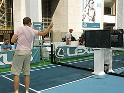 Getting ready to serve against a virtual opponent, courtesy Nintendo's Wii.