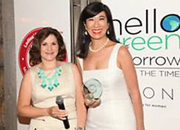 Ladies' Home Journal Editor in Chief Sally Lee presents Avon Products Chairman-CEO Andrea Jung with its latest Do Good Stamp for the company's Hello Green Tomorrow initiative.
