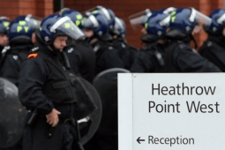 Police near Heathrow International Airport amid riots reportedly coordinated through Blackberry phones and Twitter
