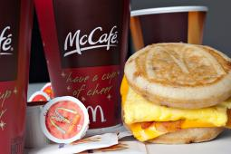 A McDonald's Corp. McGriddle breakfast sandwich is displayed with McCafe coffee for a photograph in New York, U.S., on Friday, Jan. 22, 2010.