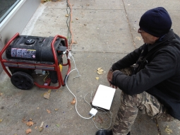 In lower Manhattan where there's still no power, you have to be innovative to stay connected.