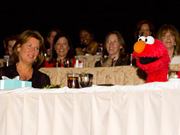 Sesame Street's Elmo surprised Sesame Workshop exec-VP and CMO Sherrie Rollins Westin with a serenade of Frankie Valli & The Four Seasons' 'Sherry Baby.'