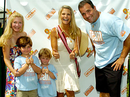 Anne Marie and David Plotkin, with their sons Max (second left) and Alex, join Christie Brinkley at the Max Cure Roar for a Cure Carnival.
