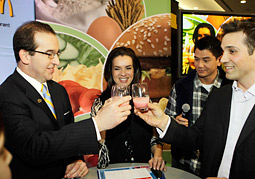 Olympic skater Katarina Witt (center) promotes McDonald's smoothies at a media event in Vancouver.