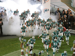 The 'home' team Miami Dolphins take the field in a decidedly American fashion.