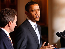 President Obama, accompanied by Treasury Secretary Timothy Geithner, speaks on the auto industry in the Grand Foyer of the White House.