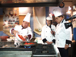 Don Francisco (right) shoots a segment at Olive Garden's Culinary Institute in Tuscany.