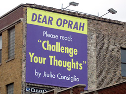 Motivational speaker Jiulio Consiglio bought a billboard one block from Ms. Winfrey's studio to hype his book.