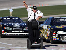 'Paul Blart: Mall Cop' star Kevin James rides a Segway as the pace car at a Nascar race in Dallas.
