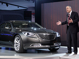 Vice Chairman Jim Press unveils the Chrysler 200C EV concept car at the North American International Auto Show.