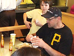 Pittsburgh Penguins coach Dan Bylsma enjoys a Qdoba burrito.