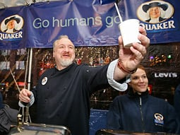 Celebrity chef Art Smith, who has cooked for the First Family and Oprah Winfrey, serves oatmeal at the Quaker Oats giveaway in Times Square this morning.