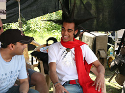 Sanjaya Malakar and his hair (right) on location in India for a Nationwide spot