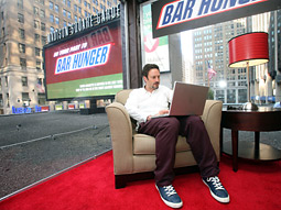 Actor/activist David Arquette hangs out in a specially outfitted lounge atop the Madison Square Garden marquee to raise awareness for Snickers' 'Bar Hunger' campaign.