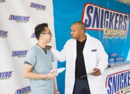 Actor Donald Faison dons lab coat for Snickers stunt