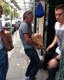 Wieden's London Managing Director Neil Christie carries bricks