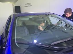 Ad Age eyes virtual passengers during a Toyota virtual reality test drive at SXSW